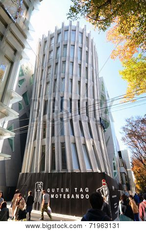 Tokyo, Japan - November 24, 2013: People Walk By Futuristic Architecture On Omotesando Street