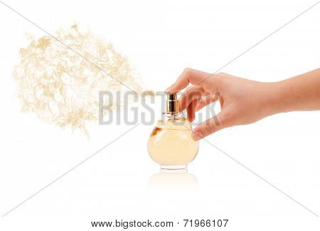 close up of woman hands spraying perfume