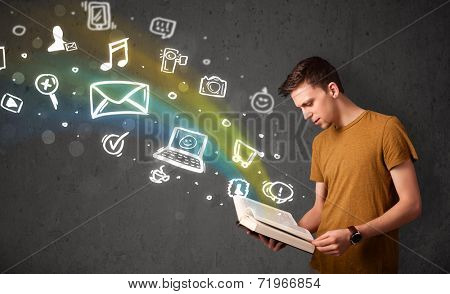 Young guy reading a book with multimedia icons coming out of the book