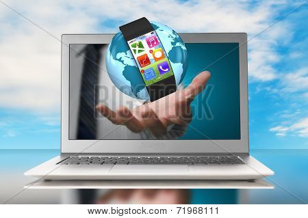 Smartwatch And Globe In Hand Through Laptop