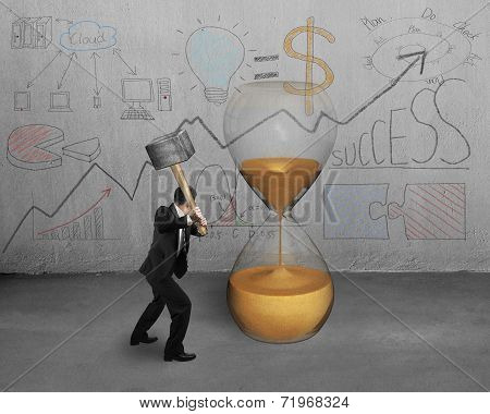 Businessman Holding Hammer To Strike Sandglass