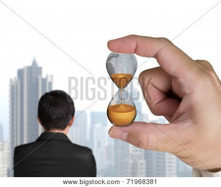 Human Hand Holding Hourglass With Businessman