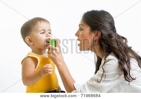 Doctor Giving Medical Spray  To Kid
