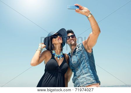 Portrait of couple taking photos with a smartphone, Couples taking Selfie