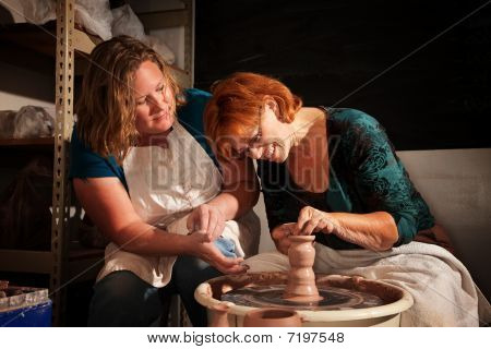 Teacher And Student In Clay Studio