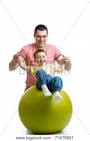 Father And Kid Son Having Fun With  Gymnastic Ball
