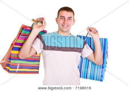 Smiling Man Holding Shopping Bags