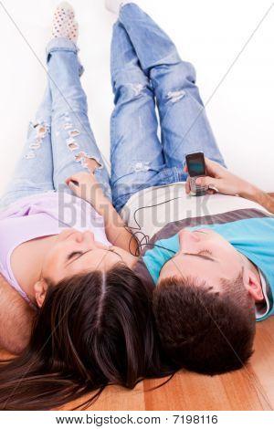 Young Couple Lying On The Floor