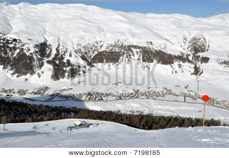 View Down Ski Slope On Chairlift Station, Valley And Impressive Mountains