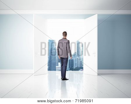 Man In Opened Doors Looking At City