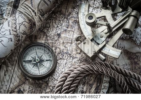vintage still life with compass,sextant and old map.map used for background is in Public domain. Map source: Library of Congress. Country: Belgium Year: 1570. Author: Abraham Ortelius (1527-1598