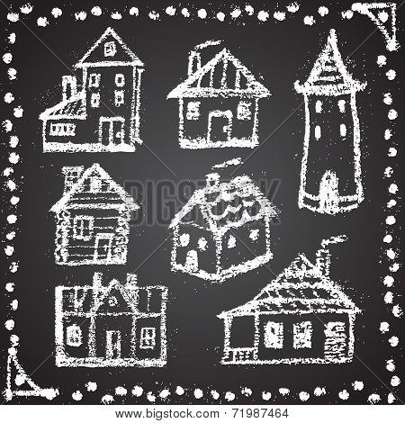 Set of snowbound chalk painted houses with ornament element. Win