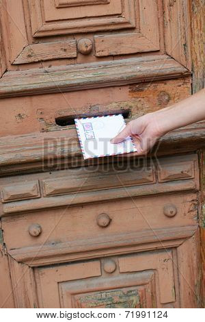 Letter in hand near postbox