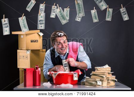 Happy businessman is laundering money