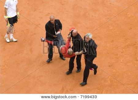 Paris - June 7:guard Service Delayed Fan Of Running In On Court At French Open, Roland Garros On Jun