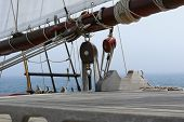 stock photo of pulley  - Detail of pulleys and hoists of a schooner - JPG
