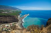 picture of canary-islands  - La Palma Canary Islands view from viewpoint Mirador el Time towards the beach Puerto de Tazacorte with chirned up sand stain on the ocean - JPG
