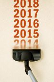 picture of new year 2014  - Vacuum Cleaner sweeping year number 2014 from Brand New Carpet leaving sequence 2015 2016 - JPG