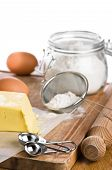 stock photo of flour sifter  - Baking ingredients with rolling pin and measuring spoons - JPG