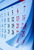 image of memento  - Month on a calendar viewd at an oblique angle with selective focus to the dates and numbers for the Friday  - JPG