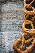 foto of pretzels  - pretzels on a dark wood background - JPG
