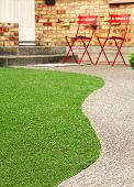 pic of grass area  - Walk way with perfect grass landscaping with artificial grass in residential area - JPG