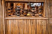 picture of primitive  - Primitive metal stoves for sale on the market in small malagasy village