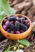 pic of mulberry  - Mulberry in bowl on wooden background - JPG