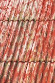 image of asbestos  - Red painted corrugated asbestos cement roof background - JPG
