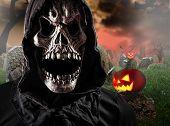 picture of reaper  - Grim reaper on graveyard - JPG