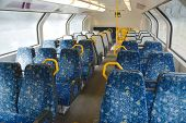 foto of passenger train  - Interior of a passenger train with empty seats - JPG