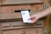 picture of postbox  - Letter in hand near postbox - JPG