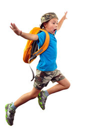 foto of running-late  - Full length portrait of a little boy with backpack and a cap running jumping waving with his hand and shouting - JPG