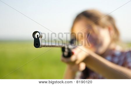 Girl  Aiming A Pneumatic Rifle