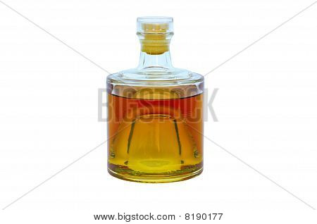 Glass bottle with alcohol on a white background