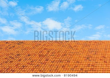 Roof Tiles And Sky With Clouds