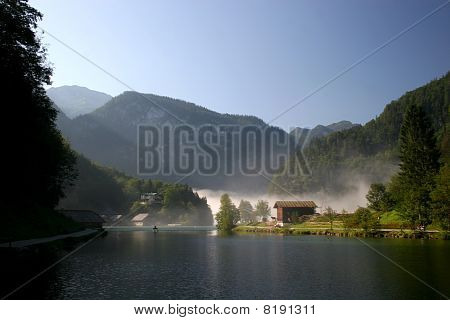 Morning fog lake Königssee in the german Alps near Berchtesgaden