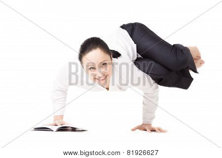 Young Woman In Formalwear Doing Fitness Exercises With Book On White Background