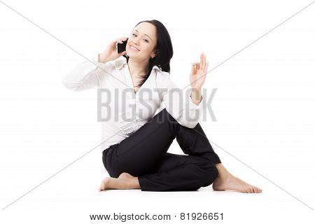 Young Business Woman In Yoga Pose Making Call On White Background