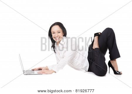 Young Office Woman Sitting In Yoga Pose In Front Of Laptop On White Background