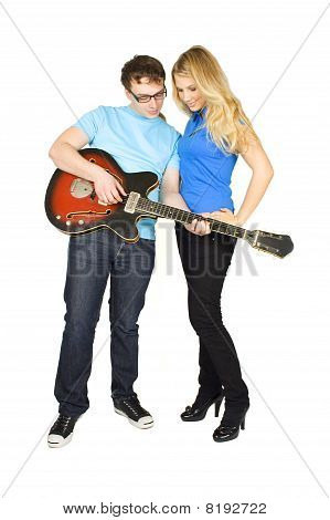 Young Man In Glasses Showing Beauty Blond Girl In Blue Shirt How To Play Guitar Isolated On White