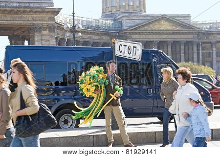Saint-Petersburg. Russia. Young man with balloon flowers