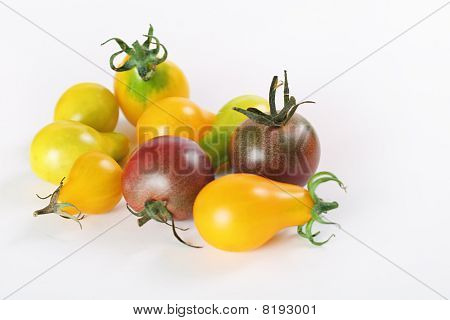 assorted baby heirloom tomatoes on white