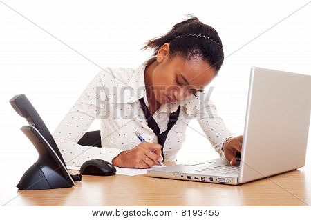 Serious Woman Sitting On The Workplace