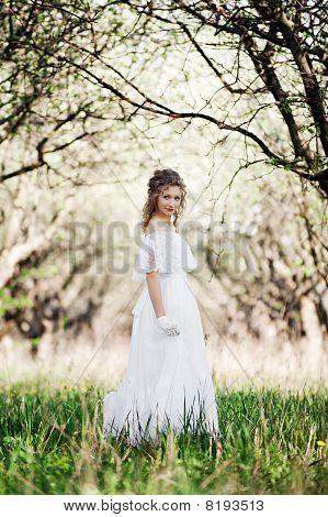 Beautiful Woman In White Dress Walking In Park