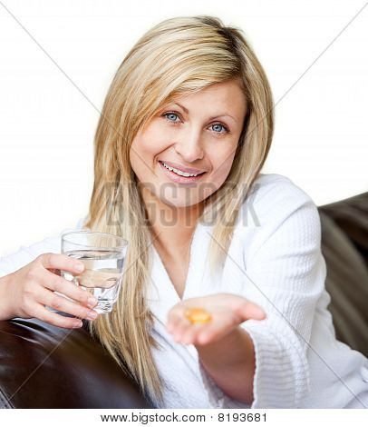 Beautiful woman taking pills