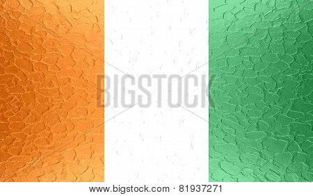 Fabric texture of Ivory Coast flag on metallic metal texture