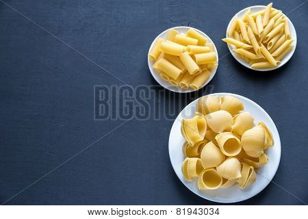 Various Types Of Pasta On The Dark Background