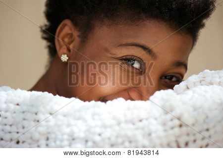 Cute Young Black Woman Covering Face And Smiling
