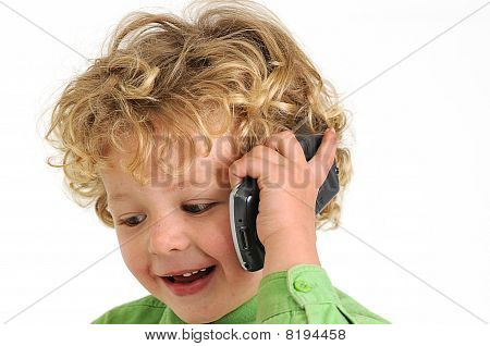 blond curly haired boy talking on mobile phone